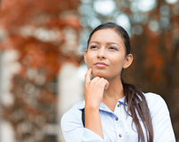 Young Businesswoman daydreaming, Thinking. Closeup portrait charming, smiling joyful happy young business woman looking upwards daydreaming something, thinking Royalty Free Stock Images