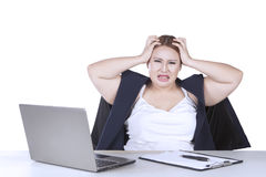 Young businesswoman depressed with job Stock Photography