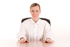Young businesswoman at desk Stock Images