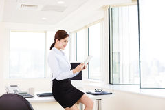 Young Businesswoman with Digital Tablet in Office Stock Photography