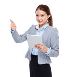 Young businesswoman with digital tablet and thumb up Royalty Free Stock Photo