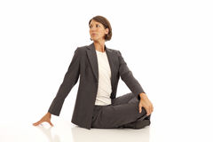 Young businesswoman doing yoga Stock Photography