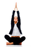 Young businesswoman doing yoga Royalty Free Stock Photos