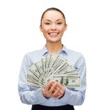 Young businesswoman with dollar cash money stock photography