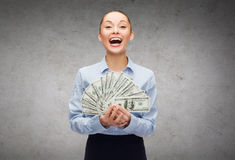 Young businesswoman with dollar cash money Royalty Free Stock Images