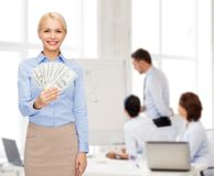 Young businesswoman with dollar cash money Royalty Free Stock Photos