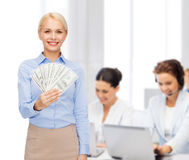 Young businesswoman with dollar cash money Royalty Free Stock Photo
