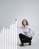 Young businesswoman drawing graph Royalty Free Stock Photos