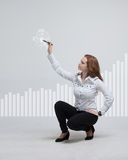 Young businesswoman drawing graph Royalty Free Stock Images