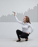 Young businesswoman drawing graph Royalty Free Stock Image
