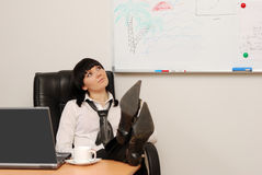 Young businesswoman dreams of a summer vacation. In office Royalty Free Stock Images