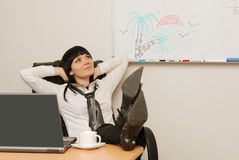 Young businesswoman dreams of a summer vacation. In office Royalty Free Stock Image
