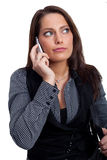 A young businesswoman in a dress is making a phone. A woman with a sellphone and a handcase, wearing a business look Stock Photos