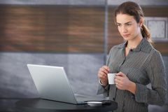 Young businesswoman drinking coffee Stock Image