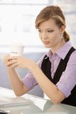 Young businesswoman drinking coffee Royalty Free Stock Images