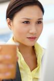 Young businesswoman drinking coffee Stock Images