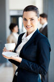 Young businesswoman drinking coffee Royalty Free Stock Photo