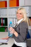 Young businesswoman is drinking water Royalty Free Stock Photo
