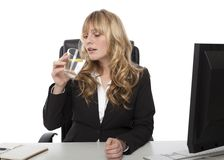 Young businesswoman drinking water and lemon Royalty Free Stock Photo