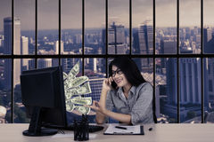 Young businesswoman earning money online Royalty Free Stock Photography