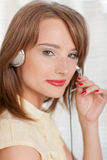 Young businesswoman in earphones at the office. Stock Photos