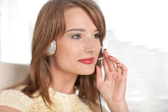Young businesswoman in earphones at the office. Royalty Free Stock Images