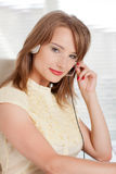 Young businesswoman in earphones at the office. Royalty Free Stock Photo