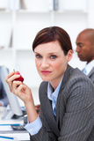 Young businesswoman eating an apple Royalty Free Stock Photos
