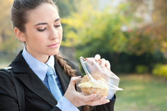 Young businesswoman eating a donut princess Stock Photo