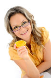 Young businesswoman eating orange Royalty Free Stock Image