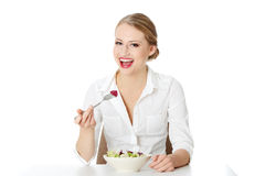 Young businesswoman eating salad Stock Photos