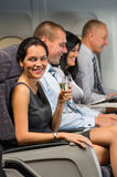 Young businesswoman enjoy flight glass champagne Stock Photos