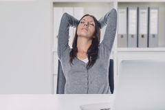Young businesswoman enjoying a relaxing moment Stock Photo