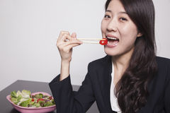 Young businesswoman enjoying a salad, portrait Royalty Free Stock Image