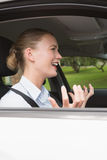 Young businesswoman experiencing road rage Stock Photo