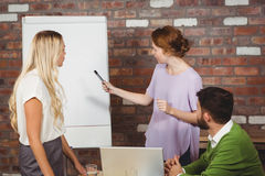 Young businesswoman explaining colleagues Stock Images