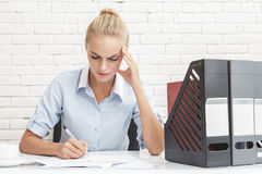 Young businesswoman feeling dizzy while working Stock Images