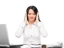 Young businesswoman feeling stressed in an office Royalty Free Stock Image
