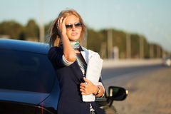 Young businesswoman with financial reports. Stock Photos