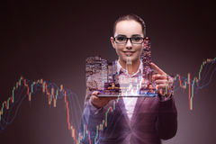 The young businesswoman in financial trading concept. Young businesswoman in financial trading concept Royalty Free Stock Images