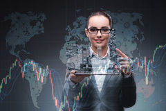 The young businesswoman in financial trading concept. Young businesswoman in financial trading concept Stock Photos