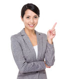 Young businesswoman with finger point upwards Stock Photos