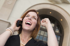 Young Businesswoman with Fist in Air On Cell Phone Stock Image