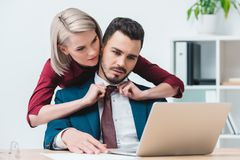 young businesswoman flirting with handsome male colleague royalty free stock image