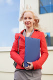 Young businesswoman with a folder. Royalty Free Stock Photos