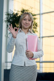 Young businesswoman with folder, paper in  lobby Stock Image