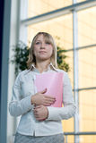 Young businesswoman with folder, paper in  lobby Stock Images