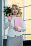 Young businesswoman with folder, paper in  lobby Royalty Free Stock Images