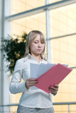 Young businesswoman with folder, paper in  lobby Stock Photography