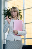 Young businesswoman with folder, paper in  lobby Royalty Free Stock Photography